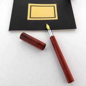 Holz-Füller Endless in Paduk aus Afrika
